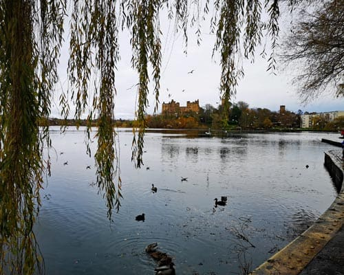 View of Linlithgow loch and Linlithgow Palace in the distance