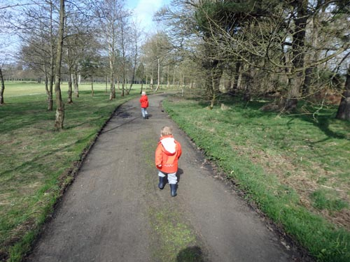 toddler and child on a walk