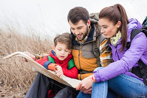 family reading a map